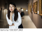Купить «Chinese female visitor looking at artwork painting in the museum», фото № 33537343, снято 7 июля 2020 г. (c) Яков Филимонов / Фотобанк Лори