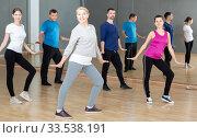 Middle-aged woman exercising at dance class. Стоковое фото, фотограф Яков Филимонов / Фотобанк Лори
