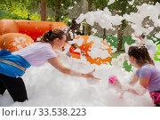 Adults collecting balls in inflatable pool with foam. Стоковое фото, фотограф Яков Филимонов / Фотобанк Лори