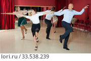 Купить «People dancing rock-and-roll in pairs», фото № 33538239, снято 4 октября 2018 г. (c) Яков Филимонов / Фотобанк Лори