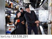 Купить «Positive cooks in process of working», фото № 33538291, снято 26 октября 2018 г. (c) Яков Филимонов / Фотобанк Лори
