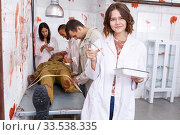 Купить «Cheerful girl in escape room stylized as medical room», фото № 33538335, снято 8 октября 2018 г. (c) Яков Филимонов / Фотобанк Лори