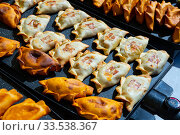 Empanada - popular dish on the Iberian Peninsula and in Latin America. Стоковое фото, фотограф Яков Филимонов / Фотобанк Лори