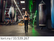 Woman jumps with a skipping rope, boxing training. Стоковое фото, фотограф Tryapitsyn Sergiy / Фотобанк Лори