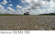 Car, road, camera under the car. Стоковое видео, видеограф Mikhail Erguine / Фотобанк Лори