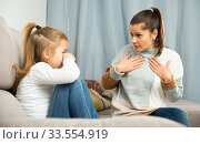 Woman having communication conflict with small daughter crying. Стоковое фото, фотограф Яков Филимонов / Фотобанк Лори