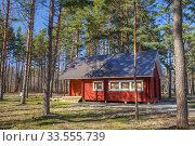 A wooden house in forest in scandinavian style, Estonia. Стоковое фото, фотограф Юлия Кузнецова / Фотобанк Лори