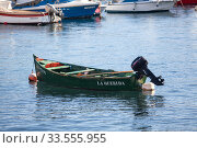 """City sea port with moored small fishing boat is in Candelaria. """"La querida"""" is the name of boat. The Candelaria town is a popular touristic place (2016 год). Редакционное фото, фотограф Кекяляйнен Андрей / Фотобанк Лори"""