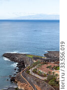 Купить «The La Gomera island is on horizon on the Atlantic ocean. Empty beach of the Playa Paraiso. Tenerife, Canary islands. Spain», фото № 33556019, снято 5 января 2016 г. (c) Кекяляйнен Андрей / Фотобанк Лори