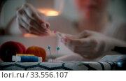 Купить «Young woman designer putting pins in the holder», видеоролик № 33556107, снято 4 июля 2020 г. (c) Константин Шишкин / Фотобанк Лори
