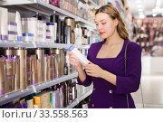 Купить «girl purchasing in cosmetics store», фото № 33558563, снято 24 февраля 2020 г. (c) Яков Филимонов / Фотобанк Лори