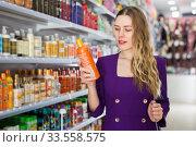 Купить «girl searching hair care treatments», фото № 33558575, снято 24 февраля 2020 г. (c) Яков Филимонов / Фотобанк Лори