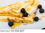Купить «Thin pancakes with brie and honey», фото № 33558807, снято 9 июля 2020 г. (c) Яков Филимонов / Фотобанк Лори