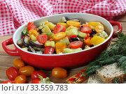 Купить «Vegetable stew with eggplant and zucchini on a wooden background», фото № 33559783, снято 15 апреля 2020 г. (c) Марина Володько / Фотобанк Лори