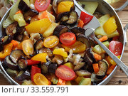 Купить «Vegetable stew with eggplant and zucchini on a wooden background», фото № 33559791, снято 15 апреля 2020 г. (c) Марина Володько / Фотобанк Лори