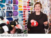 Купить «Woman choosing yarn for knitting», фото № 33564819, снято 10 мая 2017 г. (c) Яков Филимонов / Фотобанк Лори
