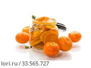 Купить «tangerine jam in a glass jar isolated on white background», фото № 33565727, снято 16 апреля 2020 г. (c) Peredniankina / Фотобанк Лори