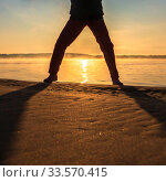 Купить «Legs of a woman on a sandy beach against the background of the rising sun. Autumn.», фото № 33570415, снято 7 сентября 2019 г. (c) Акиньшин Владимир / Фотобанк Лори