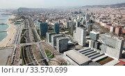 Купить «Aerial panoramic view of Barcelona modern neighborhood of Diagonal Mar i el Front Maritim del Poblenou on Mediterranean coast, Spain», видеоролик № 33570699, снято 5 марта 2019 г. (c) Яков Филимонов / Фотобанк Лори