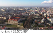 Купить «Aerial view of Renaissance building of Rzeszow castle on background of modern cityscape in springtime, Poland», видеоролик № 33570891, снято 10 марта 2020 г. (c) Яков Филимонов / Фотобанк Лори