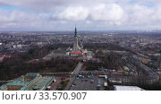Купить «Aerial view of active Catholic Jasna Gora Monastery in Czestochowa on background with modern cityscape in spring, Poland», видеоролик № 33570907, снято 13 марта 2020 г. (c) Яков Филимонов / Фотобанк Лори