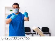 Купить «Young male doctor working in the clinic», фото № 33577155, снято 21 сентября 2019 г. (c) Elnur / Фотобанк Лори