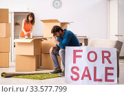 Купить «Young family offering house for sale and moving out», фото № 33577799, снято 21 сентября 2018 г. (c) Elnur / Фотобанк Лори
