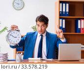 Купить «Young employee working in the office», фото № 33578219, снято 9 августа 2018 г. (c) Elnur / Фотобанк Лори