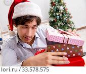 Купить «Young employee businessman in office christmas concept», фото № 33578575, снято 18 июля 2018 г. (c) Elnur / Фотобанк Лори