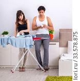 Купить «Young woman doing ironing for her husband», фото № 33578875, снято 27 июня 2018 г. (c) Elnur / Фотобанк Лори