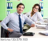 Купить «Two colleagues working in the office», фото № 33579103, снято 11 июня 2018 г. (c) Elnur / Фотобанк Лори