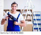 Купить «Repairman working with drilling drill perforator», фото № 33579883, снято 9 декабря 2016 г. (c) Elnur / Фотобанк Лори