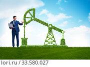 Businessman and green oil energy concept. Стоковое фото, фотограф Elnur / Фотобанк Лори