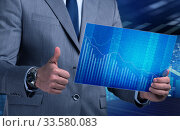 Купить «Businessman holding screen with market quotes», фото № 33580083, снято 26 мая 2020 г. (c) Elnur / Фотобанк Лори