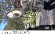 Купить «Vertical video folklore ensemble of aboriginal people of Kamchatka Peninsula dancing with tambourine in traditional clothing. Itelmens national ritual festival thanksgiving nature Alhalalalay», видеоролик № 33580675, снято 14 сентября 2019 г. (c) А. А. Пирагис / Фотобанк Лори