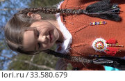 Купить «Vertical footage girl dancing on scene in traditional clothing of aboriginal people of Kamchatka during Itelmens national ritual festival thanksgiving nature Alhalalalay. Kamchatka Peninsula», видеоролик № 33580679, снято 14 сентября 2019 г. (c) А. А. Пирагис / Фотобанк Лори