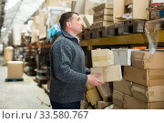 Man warehouse worker carrying boxes. Стоковое фото, фотограф Яков Филимонов / Фотобанк Лори