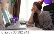 Купить «Woman celebrating birthday from home», видеоролик № 33582843, снято 19 апреля 2020 г. (c) Сергей Петерман / Фотобанк Лори