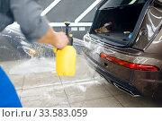 Купить «Specialists applies car protection film on bumper», фото № 33583059, снято 20 марта 2020 г. (c) Tryapitsyn Sergiy / Фотобанк Лори