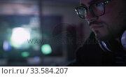 Купить «Caucasian man typing on computer keyboard in creative office», видеоролик № 33584207, снято 6 июня 2019 г. (c) Wavebreak Media / Фотобанк Лори