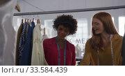 Two women choosing clothes in fashion office. Стоковое видео, агентство Wavebreak Media / Фотобанк Лори