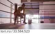 Купить «Mixed race woman resting in boxing gym», видеоролик № 33584523, снято 15 мая 2019 г. (c) Wavebreak Media / Фотобанк Лори