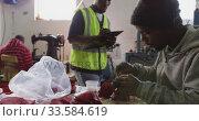 Mixed race man checking work quality in factory. Стоковое видео, агентство Wavebreak Media / Фотобанк Лори