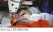 Купить «Close up view of woman using sewing machine in factory », видеоролик № 33584635, снято 23 мая 2019 г. (c) Wavebreak Media / Фотобанк Лори