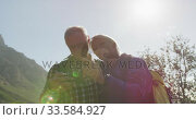 Senior couple searching direction on smartphone on mountains. Стоковое видео, агентство Wavebreak Media / Фотобанк Лори