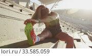 Купить «Caucasian athlete stretching in stadium», видеоролик № 33585059, снято 28 августа 2019 г. (c) Wavebreak Media / Фотобанк Лори