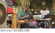 Купить «African men sewing together», видеоролик № 33585343, снято 19 сентября 2019 г. (c) Wavebreak Media / Фотобанк Лори