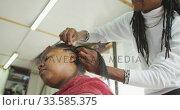 Купить «African man adding hair extensions», видеоролик № 33585375, снято 19 сентября 2019 г. (c) Wavebreak Media / Фотобанк Лори