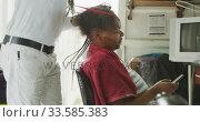 Купить «African man adding hair extensions», видеоролик № 33585383, снято 19 сентября 2019 г. (c) Wavebreak Media / Фотобанк Лори