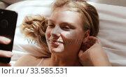 Купить «Close up view of caucasian woman using smartphone in hotel», видеоролик № 33585531, снято 13 мая 2019 г. (c) Wavebreak Media / Фотобанк Лори